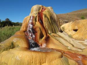 The biggest geyser provides striking colours against the blue sky